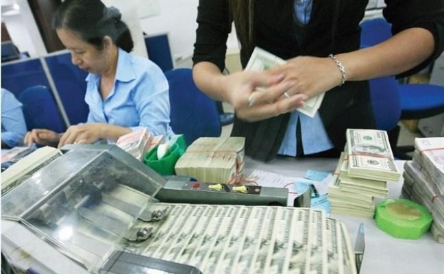Tỷ giá USD/VND ngày 26/2: Giá USD chợ đen tăng mạnh, các NHTM điều chỉnh trái chiều nhau
